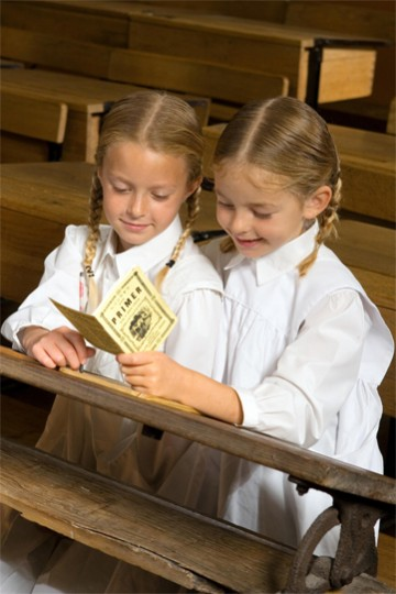 two girls reading in costume