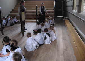 children having lesson in the Wilderspin gallery