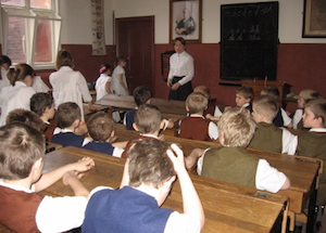 children having lesson in Victorian Schoolroom