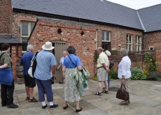 adult visitors looking round the museum playground