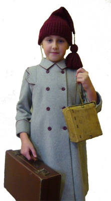young girl dressed as war evacuee