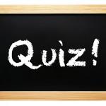 quiz written on blackboard slate