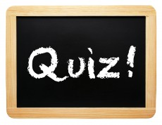 quiz written on blackboard slate